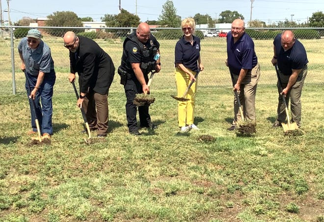 The first shovel-fulls of dirt are turned during a ceremony last week to kickoff the expansion at the Garden City Animal Shelter by the Finney County Humane Society. The work is scheduled to begin on Wednesday.
