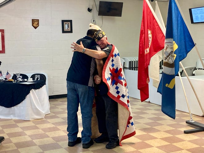 Grethel Humphrey presents Randall Cox the Quilt of Valor during a Disabled American Veterans meeting in Jacksonville, Sept. 27, 2021.