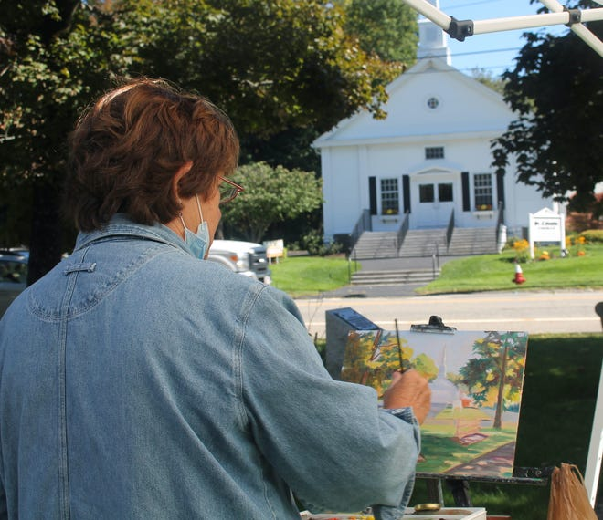 PAXTON - Artist Linda Spencer works on an oil painting featuring the St. Columba Parish Church as part of the Paxton Cultural Council's event on the town common Sept. 24.