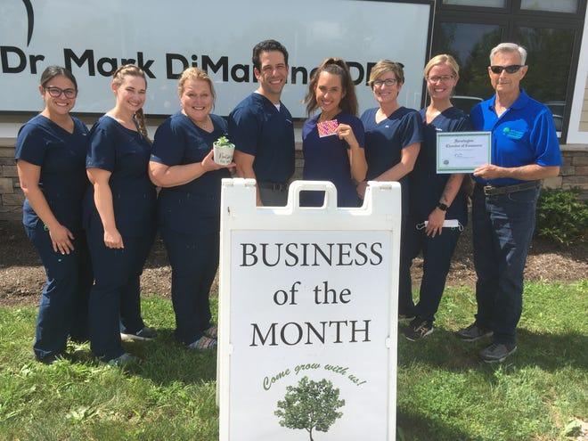 Dr. Mark DiMartino's dental office, located on Hathaway Drive in Farmington, is the Business of the Month for September 2021. The award was presented by Jim Crane, president of the Farmington Chamber of Commerce.