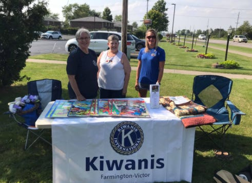 Farmington-Victor Kiwanians Barb Years, Diane McDermott and Heidi King sell coloring books and raffle tickets for a quilt at the Farmington Farmers Market.