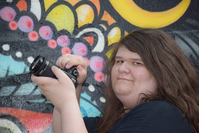 """Loki Boone, age 13, is a self taught photographer. He's taking pictures of local businesses in Dunsmuir.  """"I want to show Dunsmuir to the world and make Dunsmuir more popular,"""" Loki said."""
