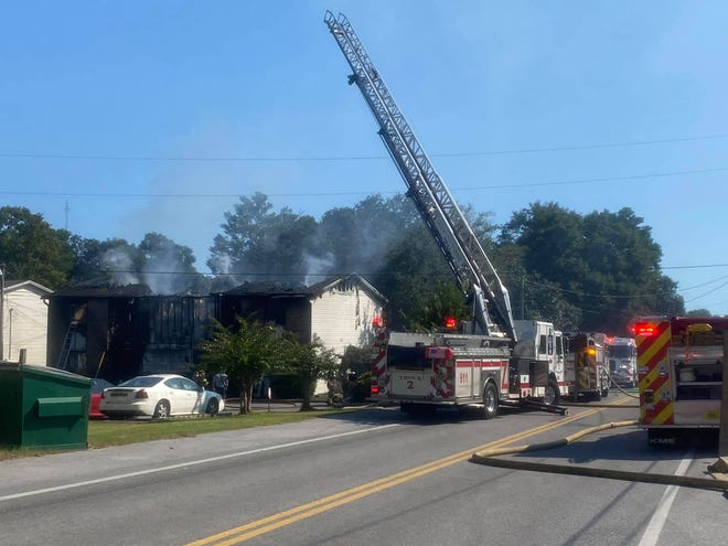 Firefighters respond to a blaze that broke out Sunday afternoon at a four-unit apartment complex on Green Street in Fort Walton Beach. One person was taken to an area hospital with minor injuries.