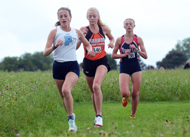 Petoskey's Caroline Farley (front), Harbor Springs' Maye Burns (middle) and Boyne City's Ava Maginity keep pace with each other near the front of Saturday's Petoskey Invitational.