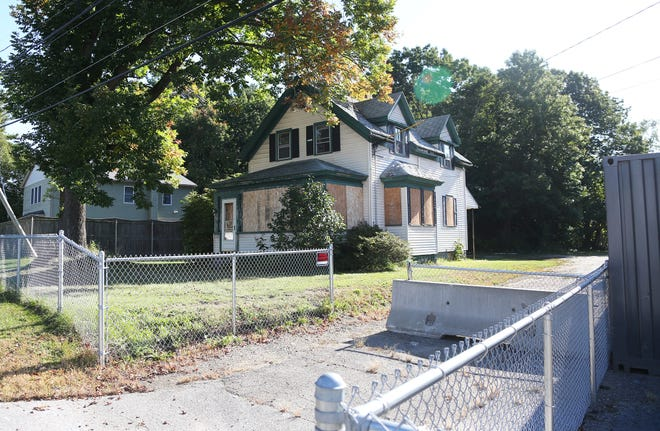 The 42 and 44 Old Post Road properties formerly owned by James Dineen have been obtained by the town through tax foreclosure. Now, the town is seeking an outside firm to lead redevelopment efforts of the site centered around affordable housing units.