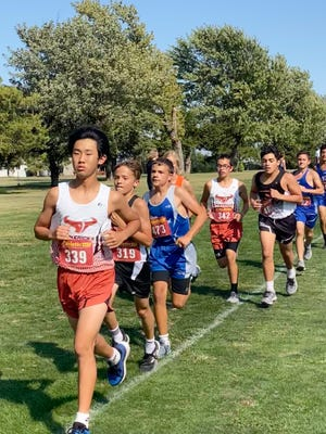 Jisung Chang (front) and Samuel Martinez (Maverick 342) are 8th grade runners for Kiowa County this year on the cross country team.