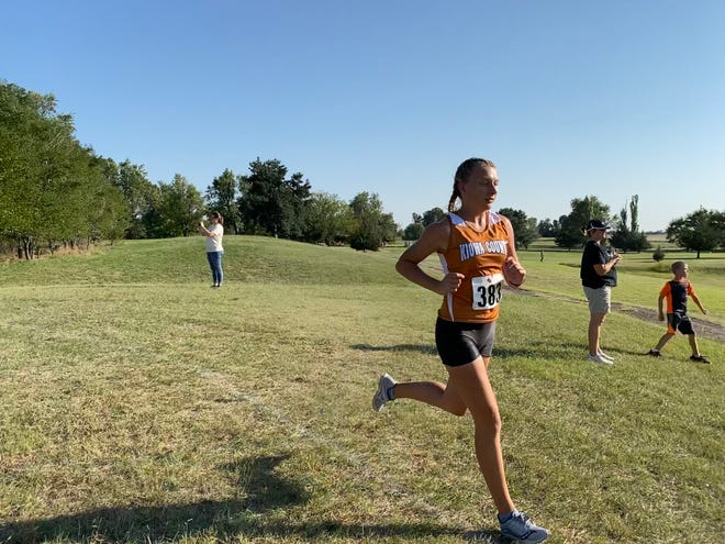 Maverick Alex Redecop strides through a turn on the course at a recent cross country competition.
