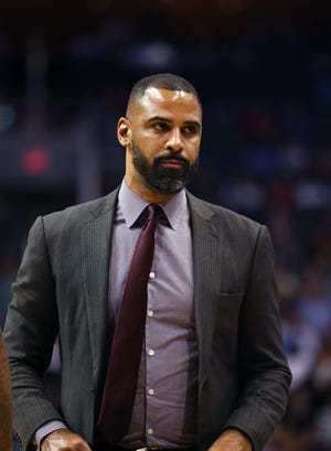 Celtics head coach Ime Udoka, shown when he was an assistant coach with the San Antonio Spurs, attended his new team's Media Day virtually on Monday because he had tested positive for COVID-19 several days earlier.