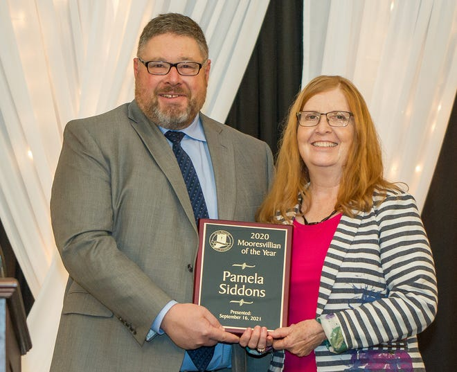 Pamela Siddons is presented with the 2020 Mooresvillian of the year at the Mooresville Chamber Annual Dinner on Sept. 16.