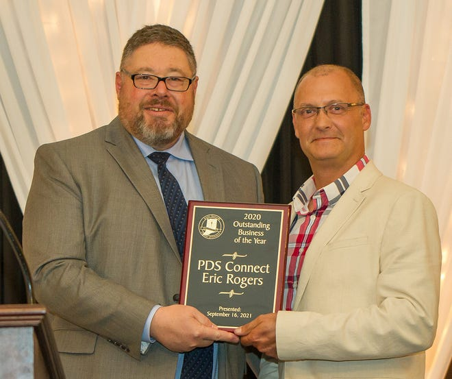 Eric Rogers is presented with the 2020 Business of the Year Award for PDS Connect at the Sept. 16 Mooresville Chamber Annual Dinner.