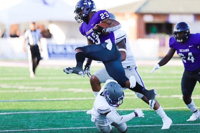 Tarleton's Daniel Wright Jr. (No. 23) jumps over defender during the Texans' game on Saturday against New Mexico Highland. Wright averaged 9.5 yards per carry on 15 tries, totaling 142 yards and two touchdowns in the Texans 40-21 win.