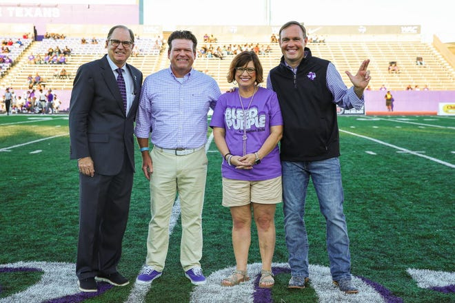 State Rep. DeWayne Burns, second from left, was on hand for Saturday's home football game against New Mexico Highlands to present a personal contribution to Tarleton State University in support of the revived men's golf program. Pictured with Burns are Tarleton Athletic Director Lonn Reisman, left, Burns' wife Jennifer, and Tarleton State University President James Hurley, right.