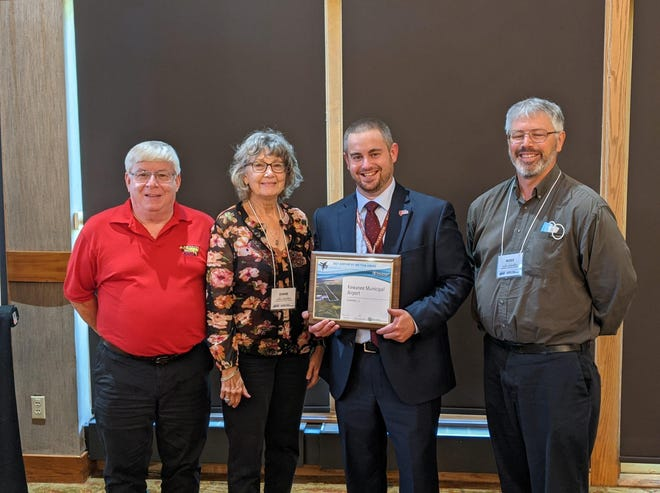 """The Kewanee Municipal Airport was recognized as """"2021 Airport of the Year- General Aviation"""" at the Illinois Aviation Conference in Galena Monday.  From left:  Jerry Huber, Kewanee Airport Board chairman, airport co-manager Diane Carbiener, Clayton Stambaugh, director of aeronautics for the State of Illinois and airport co-manager Ross Carbiener."""