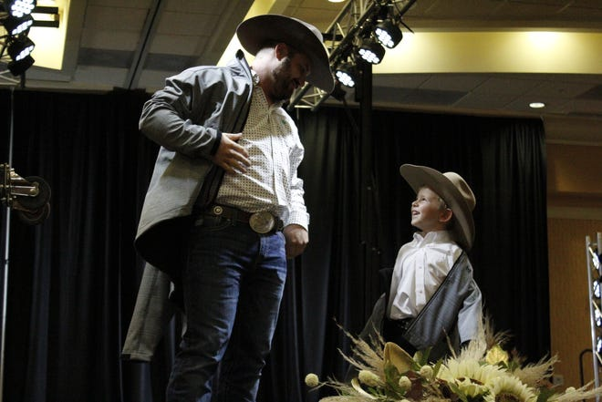 Levi Logan and his son and Kash, 4, pose for the Hitch'n Post at the fall style show hosted Sunday by Aberdeen Magazine. Local boutiques and clothing stores displayed their fall styles during the event at the Dakota Event Center.