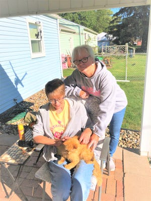 Ann Hendricks (seated) and Paulette Everhart are hoping to find a home for Cinnamon.