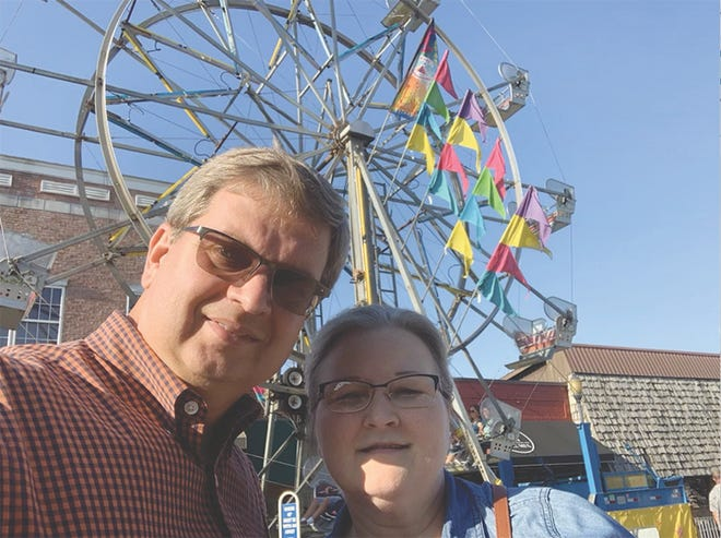 Steve and Marla Snyder of Washington celebrate the 36th anniversary of their first date at the Persimmon Festival Friday.