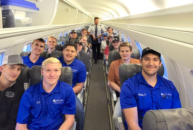 Members of the Lake Area Technical College Aviators Club and flight instructors aboard a Embraer J145. Pictured, starting in the back row from left, are Dylan Nicholson, Denver Air pilot Jon Coleman and Carson Schmahl; Cameron Pomales and Trever Bartelt; Kendall Fogarty and Trey Pearson; Will Smith, Wyatt Zachrison and Lake Area flight instructor Tyler Lotspeich; Jet Jones, Kasey Miller and Lake Area flight instructor Ben Kallas; front row, Casey Wetzel, Eli Longville and Nate Pomales.