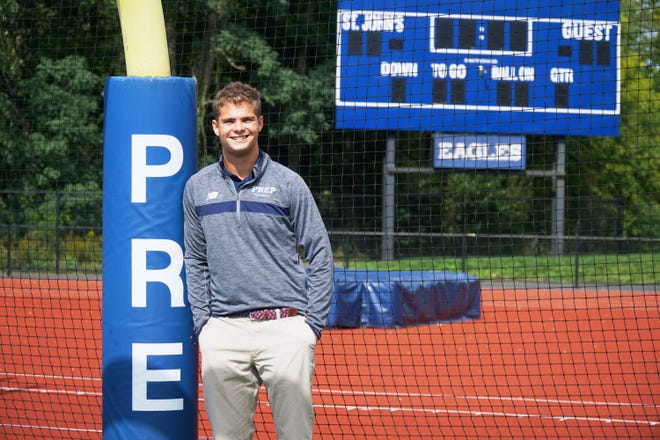 Andover's Conor Beswick, a senior at St. John's Prep, downshifted from player to team manager for the Prep football squad so he could train to run the Boston Marathon as part of a charitable effort to aid the non-profit school his special needs sister attends.