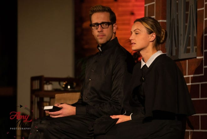 """Todd Vickstrom as Father Flynn and Alexandra Barber as Sister James in a scene from """"Doubt, a Parable."""""""
