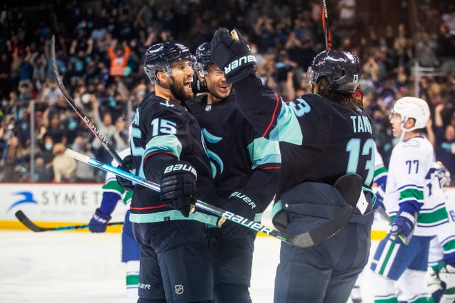 Seattle Kraken celebrate a goal that ties the game in the second period, coming from Riey Sheahan (15) in the second period of an NHL preseason hockey game against the Vancouver Canucks Sunday, Sept. 26, 2021, in Spokane.