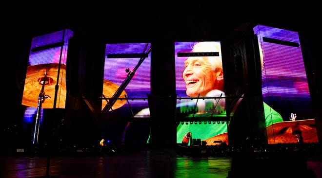"""A video tribute to Charlie Watts plays before the Rolling Stones' launch of their """"No Filter"""" tour at The Dome at America's Center on Sunday in St. Louis."""