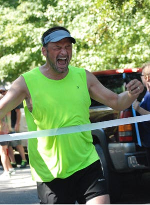 M1 Pastor Mark Lehman is shown during a former race. The local pastor is running Sunday in Mansfield to raise money to lower the cost of church camp for kids and teens.