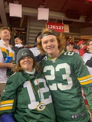 Norman Gratz (right) poses with his mom, Becky, at the Packers game against the San Francisco 49ers on Sept. 26, 2011, at Levi's Stadium. Gratz's post to Twitter right after San Francisco took a late lead went viral when Green Bay stormed back to win.