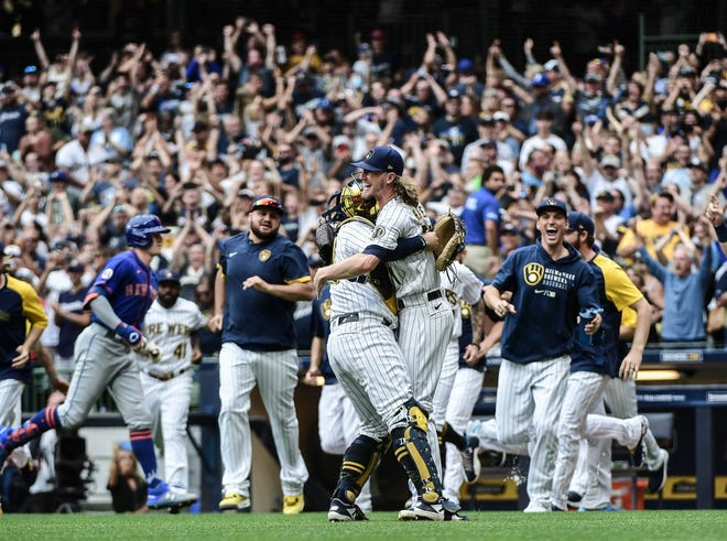 Sep 26, 2021; Milwaukee, Wisconsin, USA;  Milwaukee Brewers pitcher Josh Hader (71) celebrates after the Brewers clinched the NL Central Division at American Family Field. Mandatory Credit: Benny Sieu-USA TODAY Sports