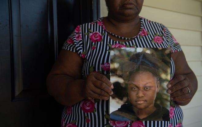 Sarah Birdsong-Tolbert holds a portrait of her granddaughter Ja'Niya Birdsong in Nashville, Tenn., Monday, Sept. 27, 2021. Ja'Niya was 16 years old when she was shot and killed Sunday night.