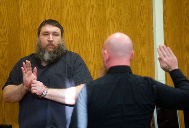 Raymond Inman is sworn in in Judge David Branstool's courtroom during his change of plea and sentencing hearing at the Licking County Courthouse in Newark, Ohio on September 27, 2021.