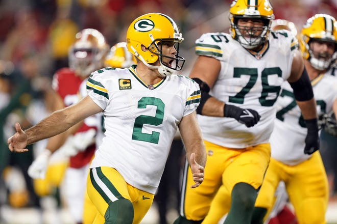 Green Bay Packers kicker Mason Crosby (2) celebrates after kicking a game-winning field goal during the fourth quarter Sunday night.