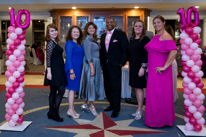 The Pensacola Breast Cancer Association hosts dinner and dancing during its annual Ribbons of Hope Charity Ball.