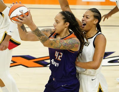 Centers Brittney Griner, left, and Liz Cambage will match up in the WNBA playoff best-of-5 semifinal series between the Phoenix Mercury and Las Vegas Aces.