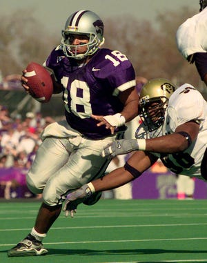 Kansas State quarterback Jonathan Beasley (18) evades a tackle by Colorado defensive tackle Jesse Warren (98)  to gain 9 yards during the final minute of the second quarter Saturday, Nov. 6, 1999 in Manhattan, Kan.  Kansas scored on the following play. Sixth-ranked Kansas State won 20-14. (AP Photo/Cliff Schiappa)