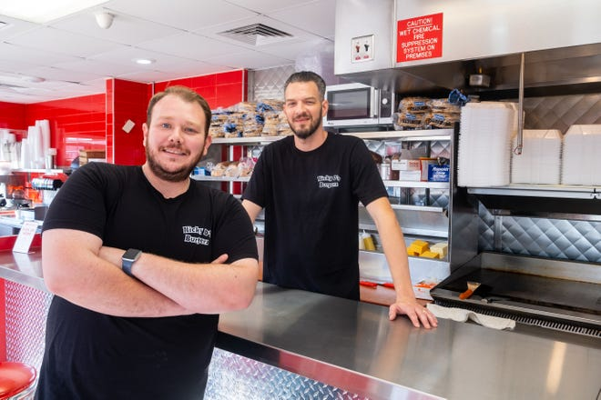 Brothers Pashk, left, and Kris Preni pose for a portrait Monday, Sept. 27, 2021, at Nicky D's Burgerz in Port Huron. After its opening was delayed for a few months, Nicky D's Burgerz in Port Huron officially opened Monday.