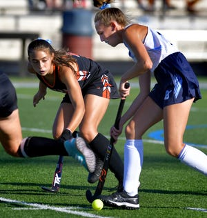Dallastown's Danielle Kapsak moves the ball against the Central York defense in field hockey action at Dallastown Monday, Sept. 27, 2021. Bill Kalina photo