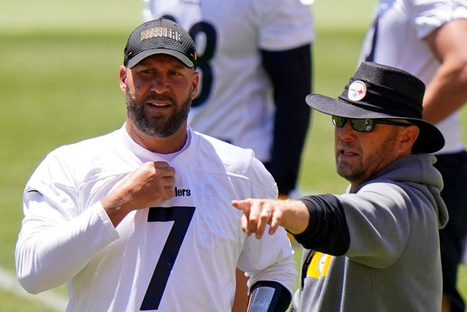 This Jun 16, 2021 file photo shows Pittsburgh Steelers offensive coordinator Matt Canada, right, talking with quarterback Ben Roethlisberger (7) during the team's NFL mini-camp football practice in Pittsburgh.  (AP Photo/Gene J. Puskar/File)