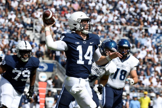 Penn State quarterback Sean Clifford (14) throws a third quarter touchdown pass to wide receiver KeAndre Lambert-Smith against Villanova during an NCAA college football game in State College, Pa., on Saturday, Sept. 25, 2021. Penn State defeated Villanova 38-17. (AP Photo/Barry Reeger)