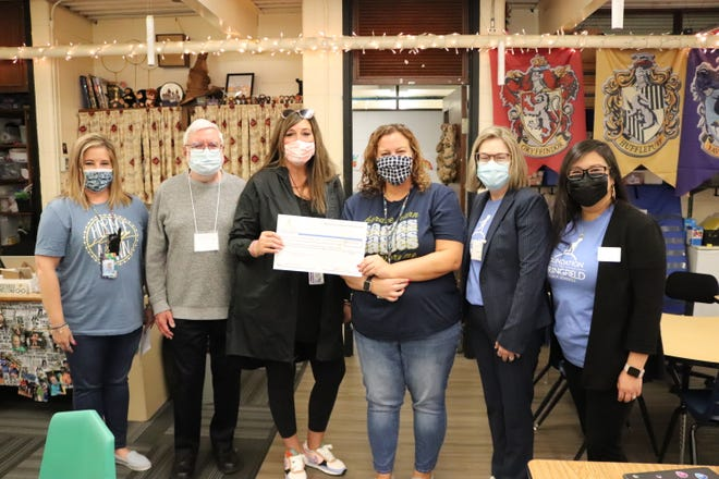 Volunteers with the Foundation for Springfield Public Schools visited classrooms Friday to surprise educators with $195,600 in back-to-school grants.