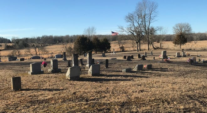 Ronnie Johnson is buried in a rural Howell County cemetery along a dirt road.
