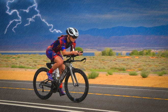 Brittany Bevis encounters a dramatic thunderstorm on the biking portion of the Ironman 70.3 World Championship held Sept. 17-18, 2021, in St. George, Utah.
