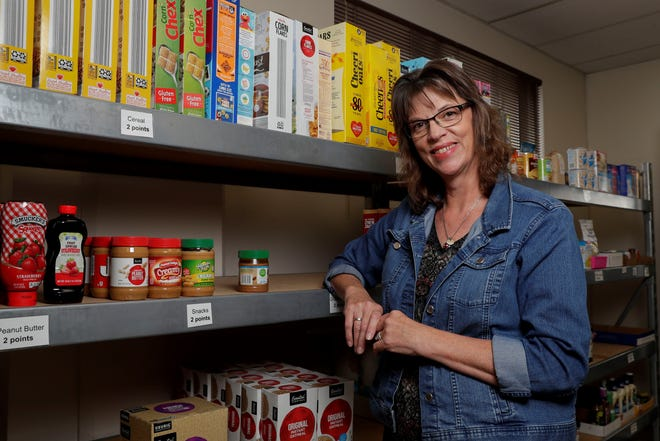 Ann Chrudinsky poses for a portrait Sept. 27 at the Salvation Army food pantry on Callon Street in Wausau. Chrudinsky was a single, working mother of two when she needed help from a food pantry, and her experience there inspired her to help others, much in the way she was helped.
