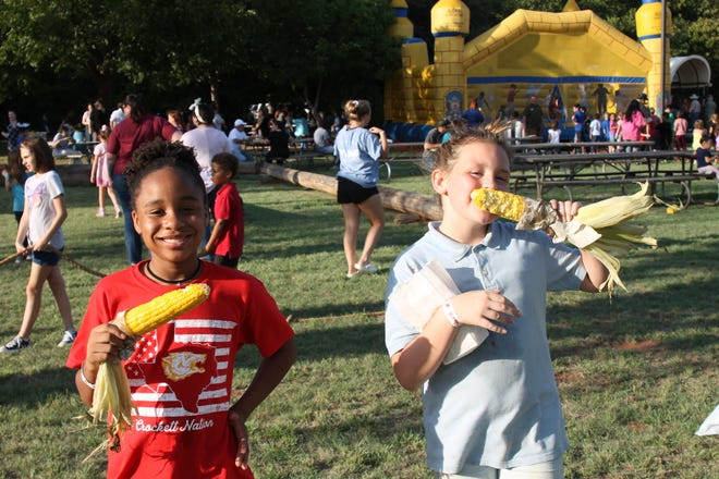 During a previous year's Camp Fire Family Fun Night, participants enjoy roasted corn on the cob. This year's event will be Thursday, Sept. 30, at Harrell Park.
