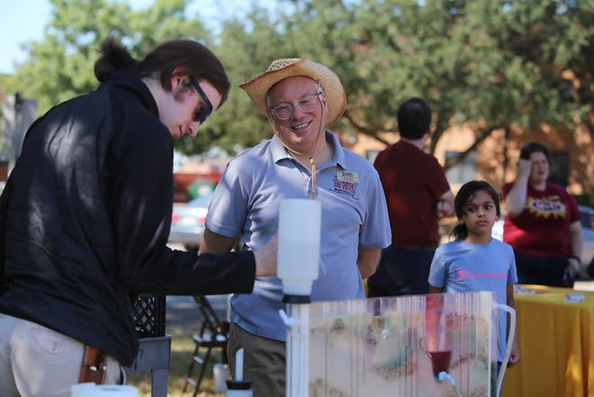 Jon Price, an associate professor of geological sciences, works with students to demonstrate how water flows underground at Midwestern State University Family Day, Saturday, Sept. 25, 2021.