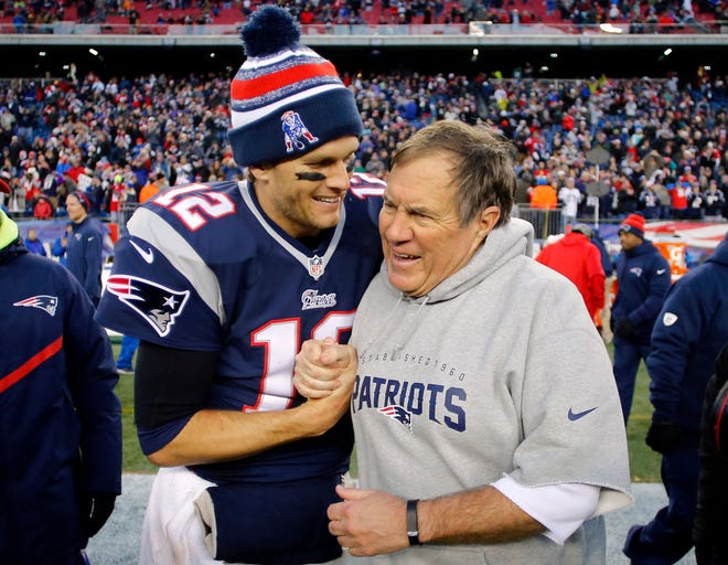 Tom Brady celebrates with Bill Belichick after one of their many victories with the Patriots.