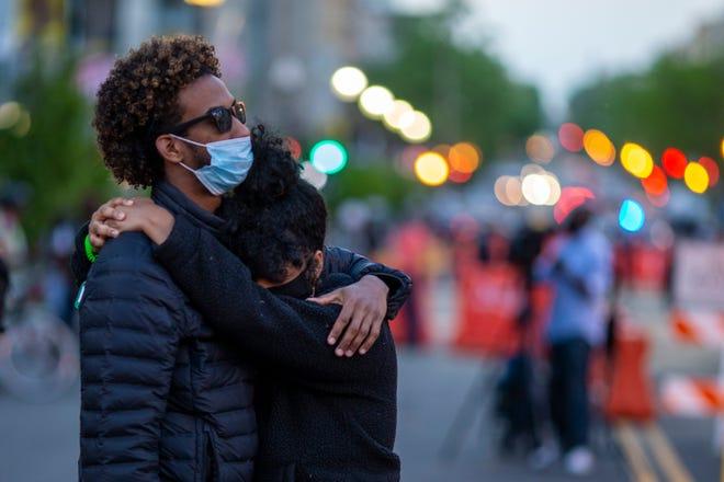 A couple embrace at Black Lives Matter Plaza near the White House on April 20.