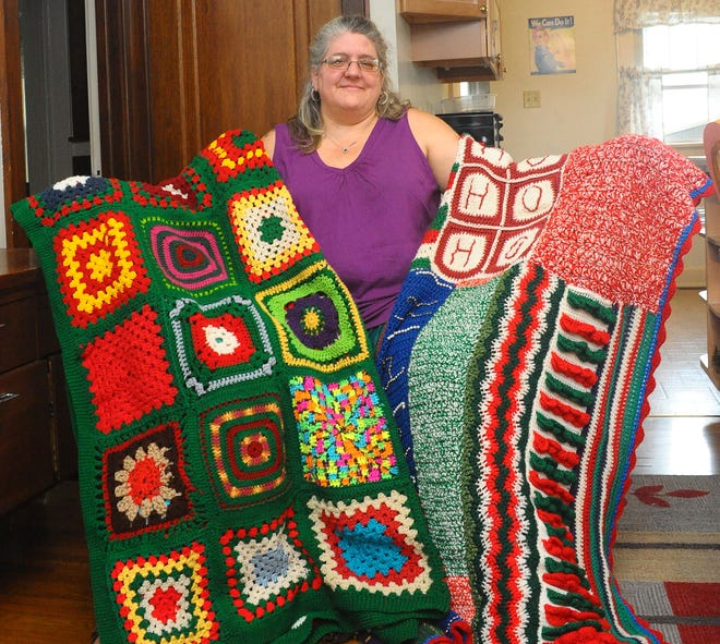 Holly Oyster holds two of the blankets that will be donated to the needy as part of a group effort holiday tree tradition in Freedom Square. Photo taken Wednesday, Sept. 22, 2021.