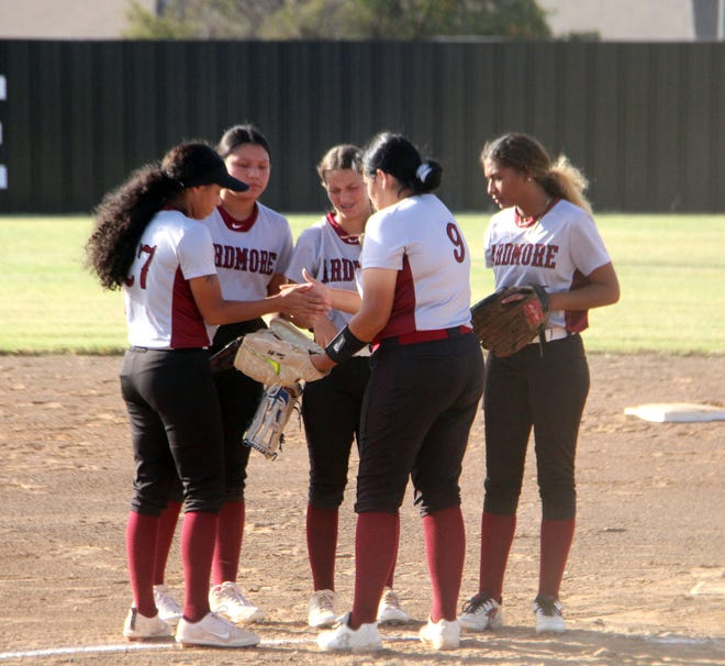 A group of Lady Tigers huddle in the circle Monday against Lawton MacArthur. Ardmore has dealt with its fair share of ups and downs during 2021, but the squad is focused on ending the season on a good note.