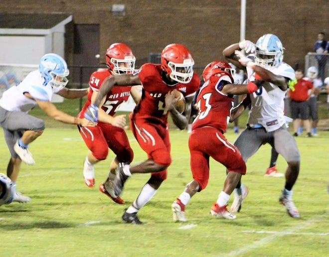 Wade Hampton's Jamian Risher (4) carries the ball with great blocking from Andrew Robinson (33) and Payton Buhler (54).