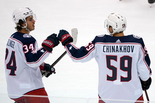 Columbus Blue Jackets' Yegor Chinakhov (59) celebrates with Cole Sillinger after scoring during the first period of an NHL exhibition hockey game against the Pittsburgh Penguins in Pittsburgh, Monday, Sept. 27, 2021.